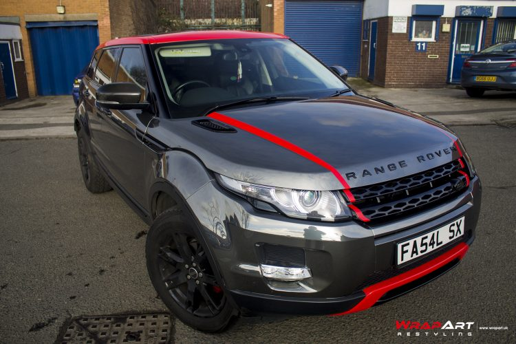 Range Rover Evoque wrapped in Titanium Black Chrome with Gloss Red accenting